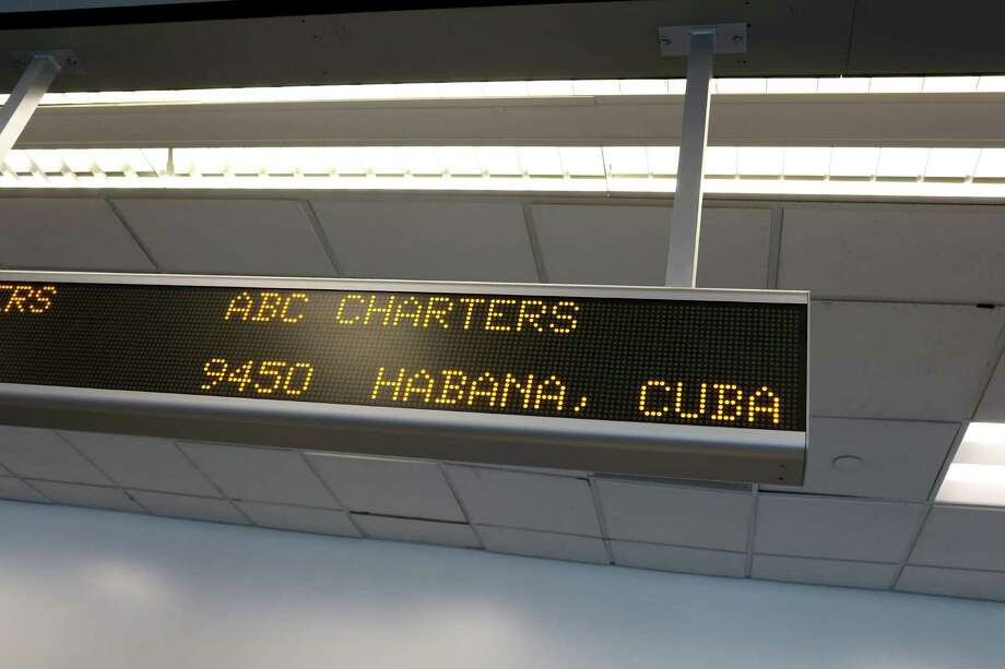 A sign indicates the ABC Charters American Airlines flight to Havana, Cuba at Miami International Airport. President Barack Obama's relaxation in Cuban policy may mean more travel between the United States and Cuba, and a consulate in Miami. Photo: Joe Raedle /Getty Images / 2014 Getty Images