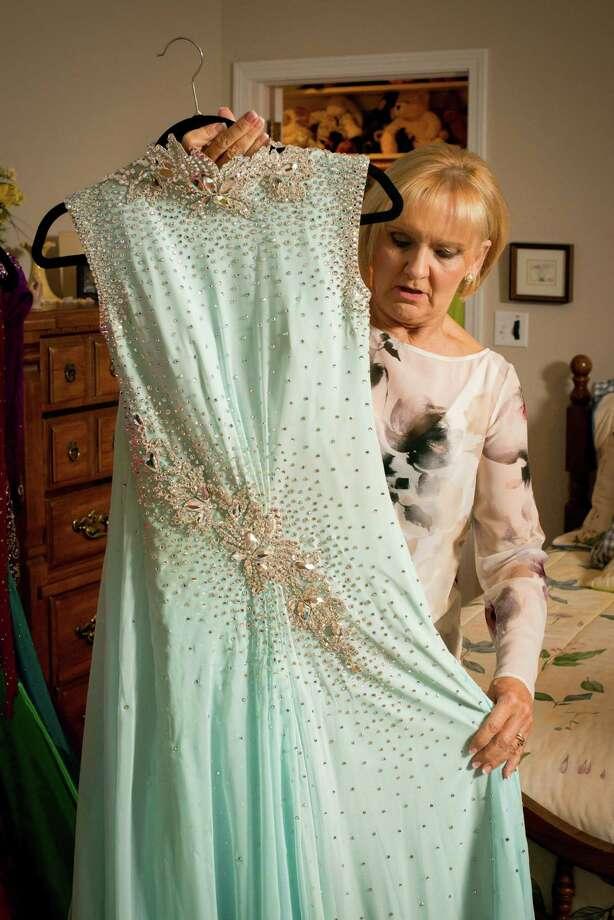 20160106_Ballroom Dress Reseller of Ballroom dancing dresses Deb Hendrickson with some of her inventory Photo: David Gunn / David Gunn / David Gunn