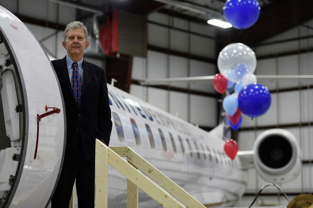 Andrew Price, president of CommutAir stands next to one his new regional jets that will be part of the CommutAir's United Express connection that will be based in part at the Albany International Airport in their new maintenance facility which was unveiled Friday Jan. 22, 2016 in Colonie, N.Y. (Skip Dickstein/Times Union)
