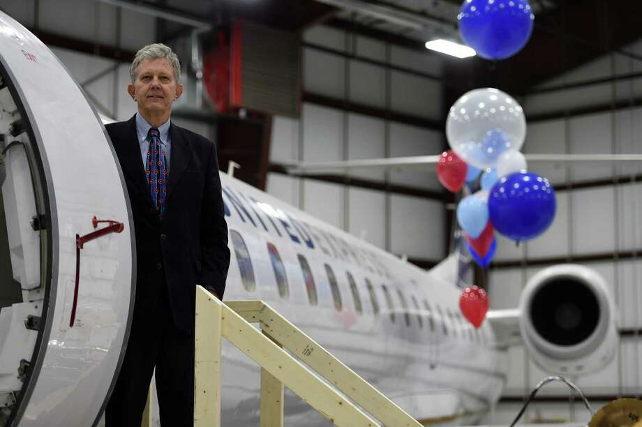 Andrew Price, president of CommutAir stands next to one his new regional jets that will be part of the CommutAir's United Express connection that will be based in part at the Albany International Airport in their new maintenance facility which was unveiled Friday Jan. 22, 2016 in Colonie, N.Y.           (Skip Dickstein/Times Union) Photo: SKIP DICKSTEIN / 10035106A