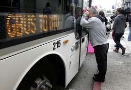 Protesters, angered by the high number of Ellis Act evictions on tenants, move in to block a Google bus at 18th and Dolores streets in San Francisco, Calif. on Friday, April 11, 2014.