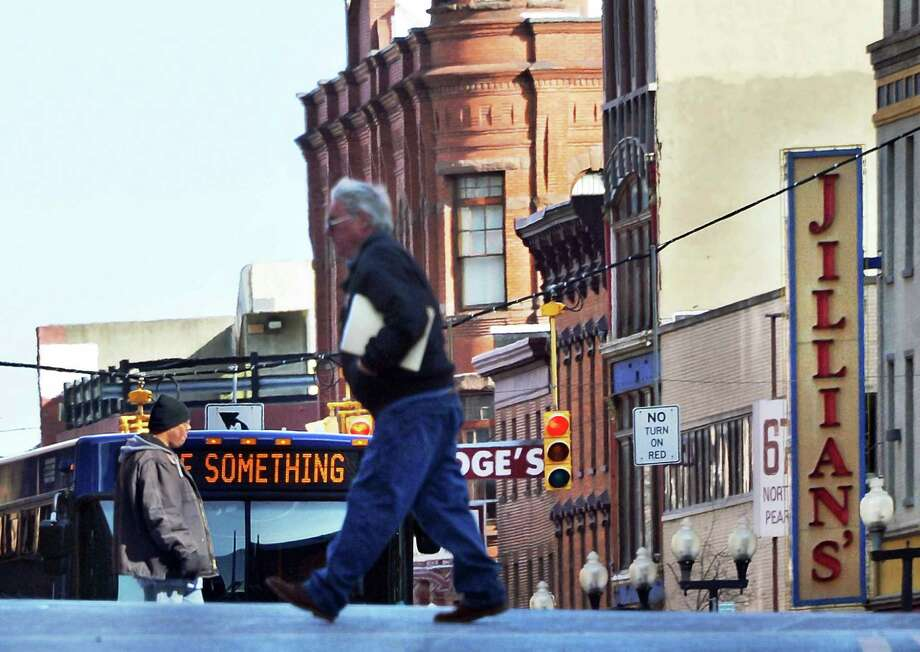 Pedestrians cross the sun-dappled intersection of State and Pearl Streets Friday, Jan. 22, 2016, in Albany, N.Y.  (John Carl D'Annibale / Times Union) Photo: John Carl D'Annibale