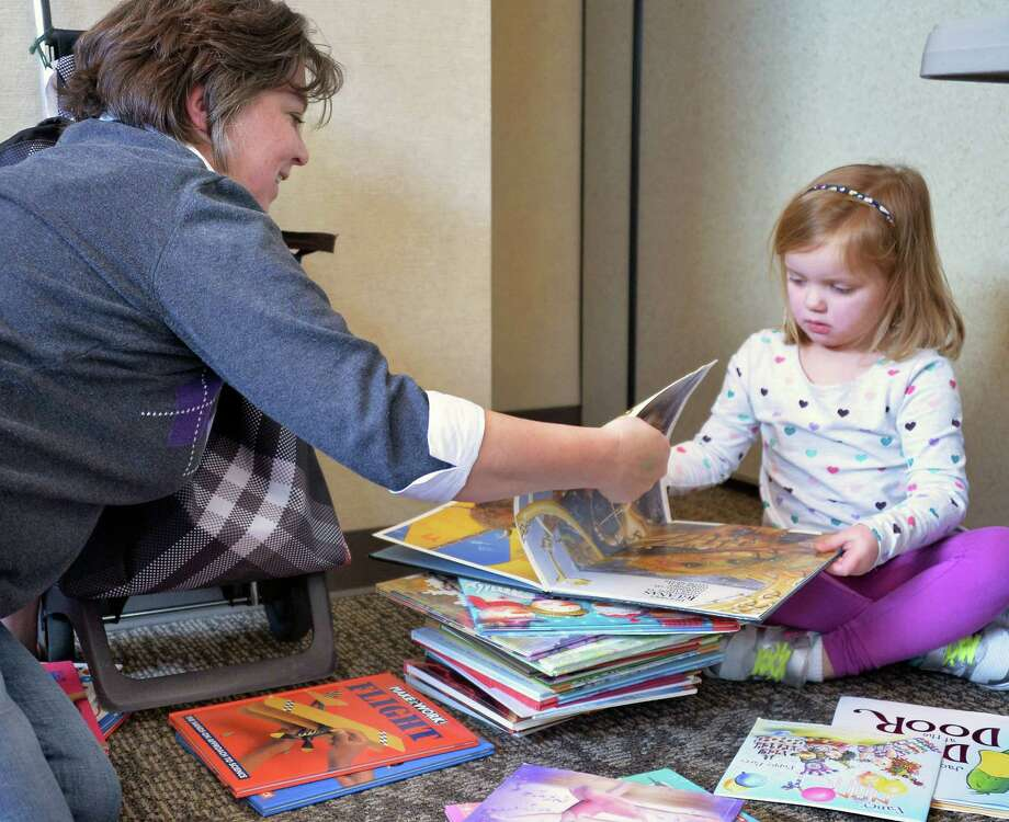 Lynda David and granddaughter Charlotte Norton, 4, of Clifton Park pick out books at the Friends of the Clifton Park-Halfmoon Public Library Book Sale,  Friday Jan. 22, 2016 in Clifton Park, NY. (John Carl D'Annibale / Times Union) Photo: John Carl D'Annibale / 10035113A