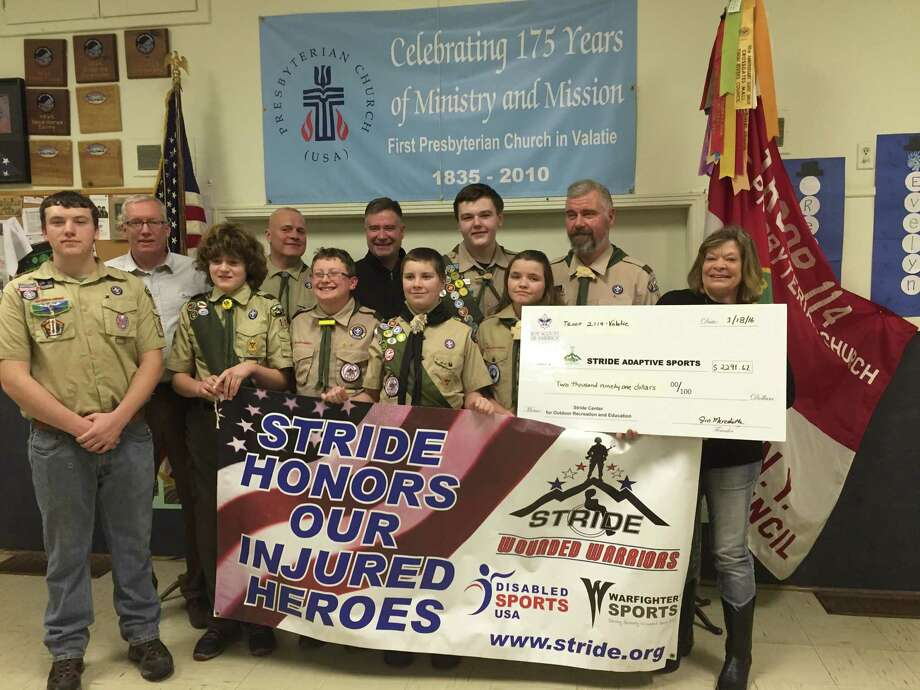 Valatie Boy Scout Troop 2114 presented a check for $2,291.62 to STRIDE Adaptive Sports CEO Mary Ellen Whitney on Jan. 18.  The troop raised the money in the 10th annual Valatie Veterans 5K run last Veterans Day. The run began and ended at Glynn Square in Valatie and was won by Dave Vona of Valatie. Rebecca Chapman of Nassau was the first female to finish and Killian O'Connor of Cohoes was the fastest scout. (Submitted photo)