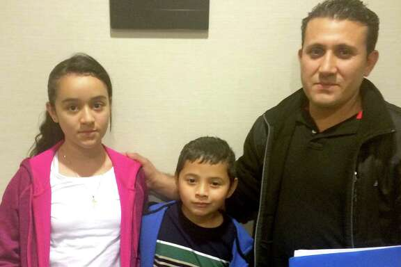 """Jose Menjivar brought his children Sandy, 11, and Steven, 7, to the U.S. after gangs followed him to Steven's school in their home country of El Salvador. Bringing them on the perilous trip was, Jose Menjivar said, """"the worst experience in my life."""""""