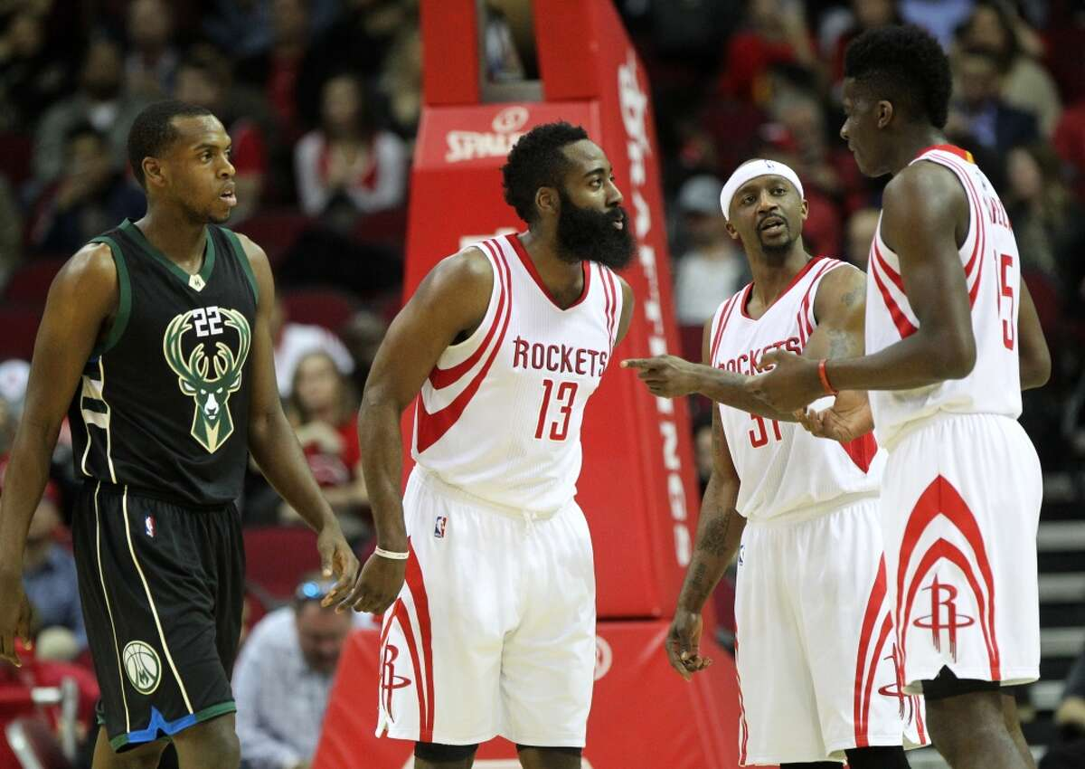 Houston Rockets guard James Harden (13) and Houston Rockets guard Jason Terry (31) talk with Houston Rockets forward Clint Capela (15) during the first quarter in a game against the Milwaukee Bucks at the Toyota Center Friday, Jan. 22, 2016, in Houston, Texas. ( Gary Coronado / Houston Chronicle )