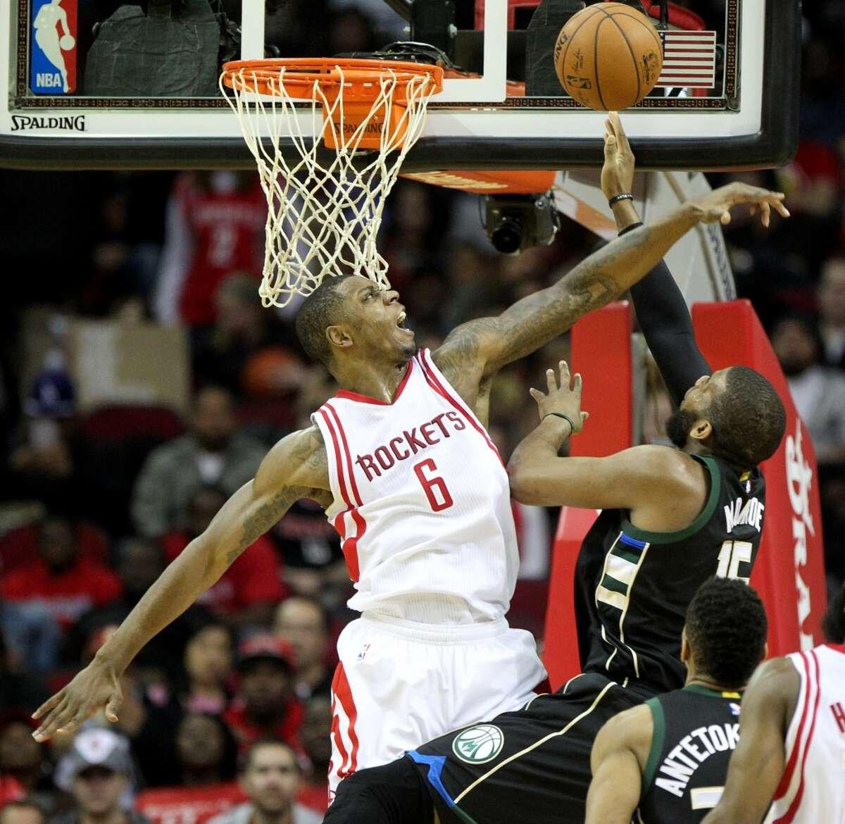 Houston Rockets forward Terrence Jones (6) blocks the shot of Milwaukee Bucks center Greg Monroe (15) during the second quarter at the Toyota Center Friday, Jan. 22, 2016, in Houston, Texas. ( Gary Coronado / Houston Chronicle )