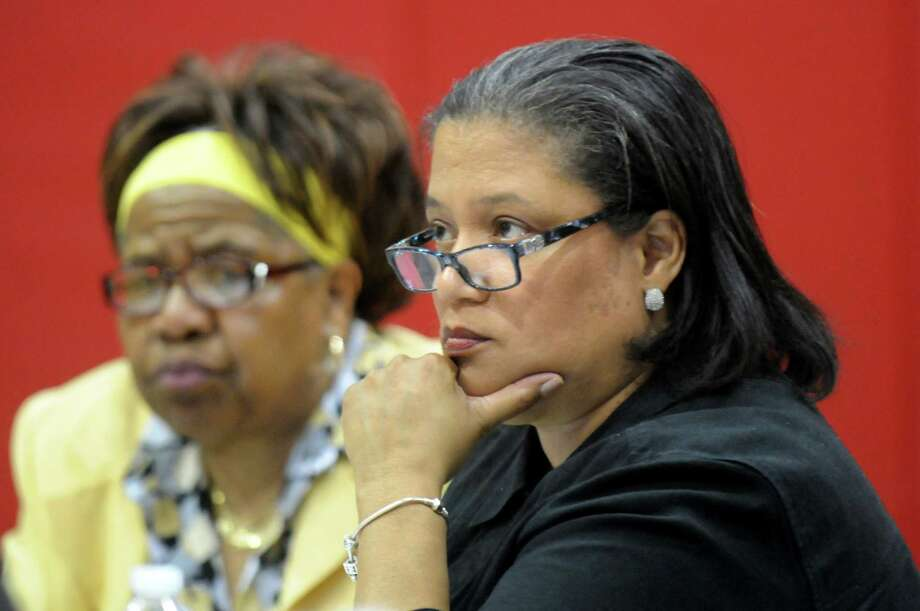 Superintendent Marguerite Vanden Wyngaard, right, listens to comments during the school board meeting on Thursday, June 4, 2015, at Pine Hills Elementary School in Albany, N.Y. At left is school board member Rose Brandon. (Cindy Schultz / Times Union) Photo: Cindy Schultz / 00032163A
