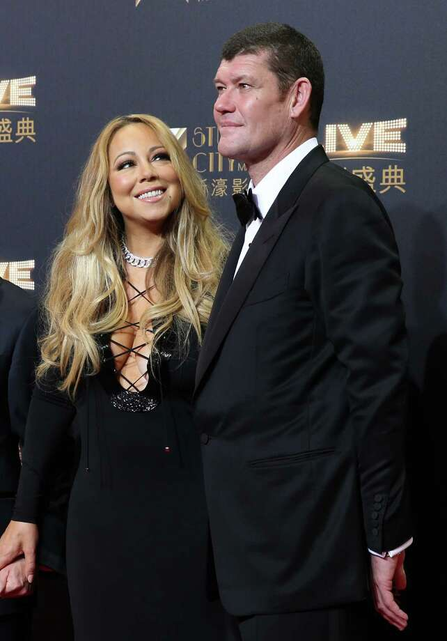 FILE - In this Oct. 27, 2015 file photo, singer Mariah Carey, left, and Australian businessman James Packer attend the opening ceremony for the Studio City project in Macau. The singer's representative said Friday that Carey and Packer got engaged in New York City on Thursday, Jan. 21, 2016. (AP Photo/Kin Cheung, File) ORG XMIT: NYET503 Photo: Kin Cheung / AP