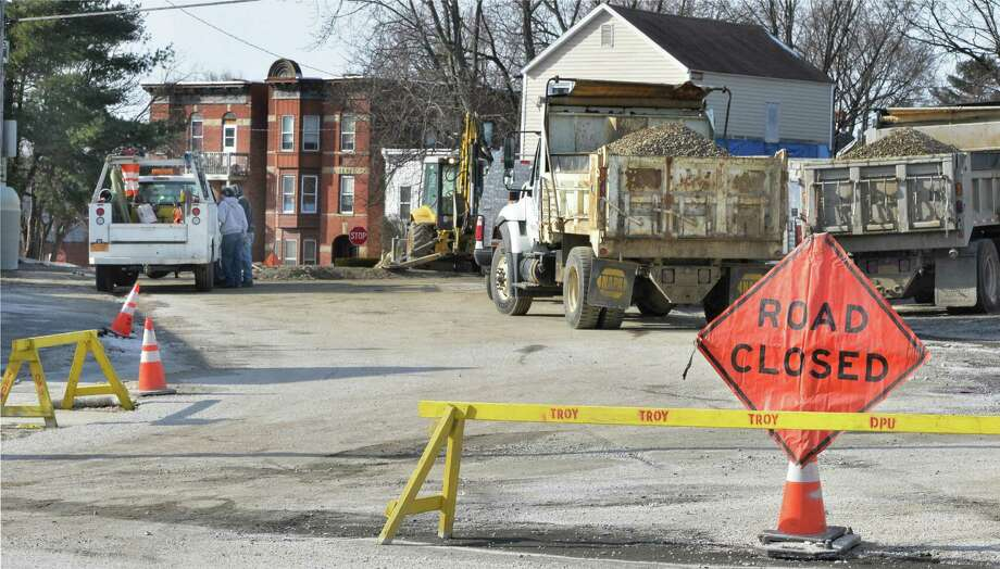 Crews continue repairs to the 110-year-old 33-inch water main at 125th Street and Fifth Avenue on Friday Jan. 22, 2016, in the Lansingburgh neighborhood of Troy, NY. The pipe burst on Sunday. (John Carl D'Annibale / Times Union) Photo: John Carl D'Annibale / 10035111A