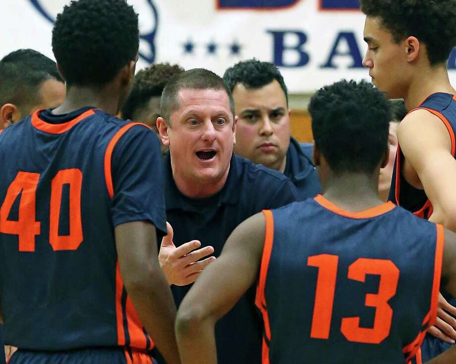 Coach Marc Gardner talks to the Broncos as Brandeis plays O'Connor in District 27-6A boys basketball at Taylor Field House  on January 22, 2016. Photo: TOM REEL, STAFF / SAN ANTONIO EXPRESS-NEWS / 2016 SAN ANTONIO EXPRESS-NEWS