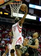 James Harden blows past Bucks forward Giannis Antetokounmpo, right, during a first-quarter move to the basket Friday night at Toyota Center. The Rockets star finished with a game-high 30 points.