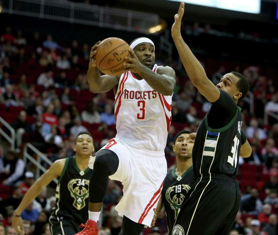 Ty Lawson (3) and interim coach J.B. Bickerstaff want the guard to return to his playmaking roots. It's something from which he strayed in the first half. Photo: Gary Coronado, Staff / © 2015 Houston Chronicle