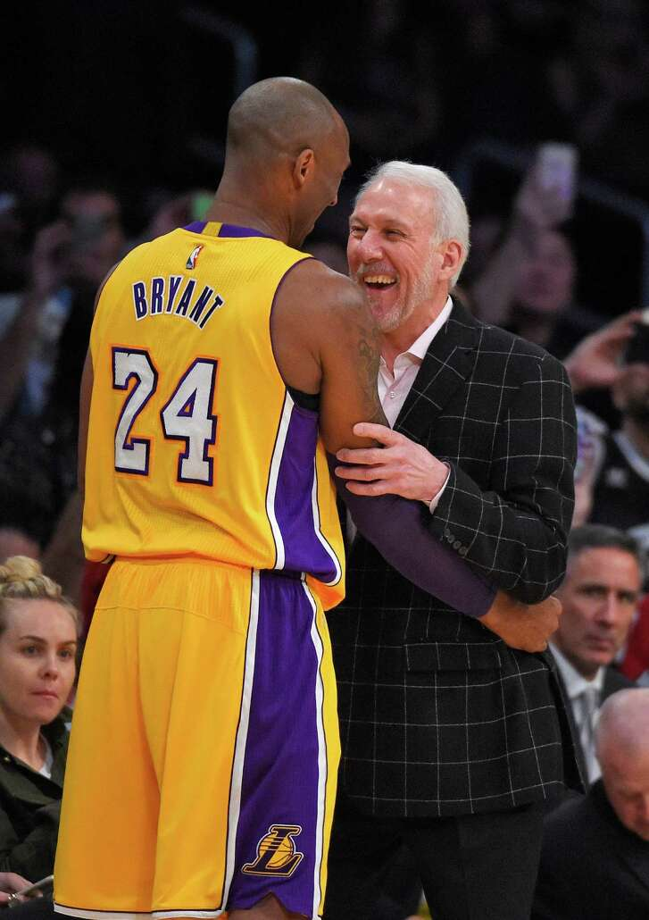 Los Angeles Lakers forward Kobe Bryant, left, talks with San Antonio Spurs coach Gregg Popovich prior to an NBA basketball game Friday, Jan. 22, 2016, in Los Angeles. (AP Photo/Mark J. Terrill)