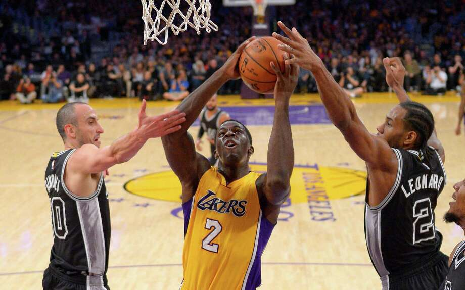 2463 x 1536~~$~~Los Angeles Lakers forward Brandon Bass shoots between San Antonio Spurs guard Manu Ginobili, left, and forward Kawhi Leonard during the first half of an NBA basketball game Friday, Jan. 22, 2016, in Los Angeles. Photo: Mark J. Terrill, AP / AP