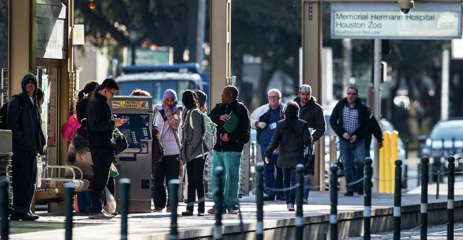 MetroRail passengers stand on the platform waiting for a train in the Texas Medical Center on Friday, Jan. 22, 2016. Photo: Brett Coomer, Houston Chronicle / © 2016 Houston Chronicle
