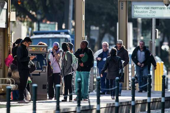 MetroRail passengers stand on the platform waiting for a train in the Texas Medical Center on Friday, Jan. 22, 2016, in Houston. Steady growth in the medical center, due to a growing Houston population, has kept the city's economy from tanking despite the fall in the energy sector.