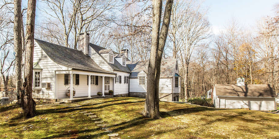 The property at 15 Greenbrier Road is on the market for $898,000. The Cape-style house, which was built in 1938, sits on nearly two acres. Photo: Contributed Photo / Westport News
