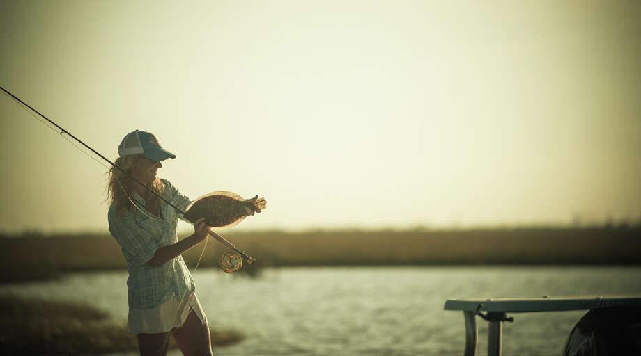 The woman who chases fly fishing records houston chronicle for Fly fishing houston