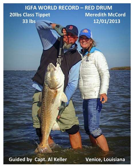Meredith McCord with a record-breaking red drum. Photo: Courtesy Meredith McCord