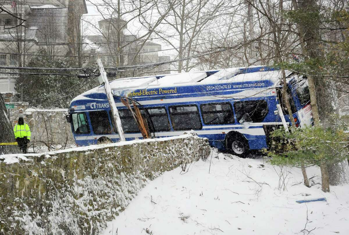 Scene of a bus accident during the winter storm on Sound View Drive in Central Greenwich, Conn., Saturday morning, Jan. 23, 2016.