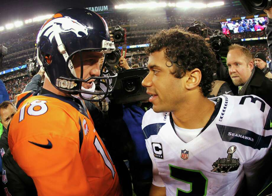 EAST RUTHERFORD, NJ - Quarterback Peyton Manning #18 of the Denver Broncos congratulates quarterback Russell Wilson #3 of the Seattle Seahawks on their 43-8 win during Super Bowl XLVIII at MetLife Stadium on February 2, 2014 in East Rutherford, New Jersey. Photo: Kevin C. Cox, Getty Images / 2014 Getty Images