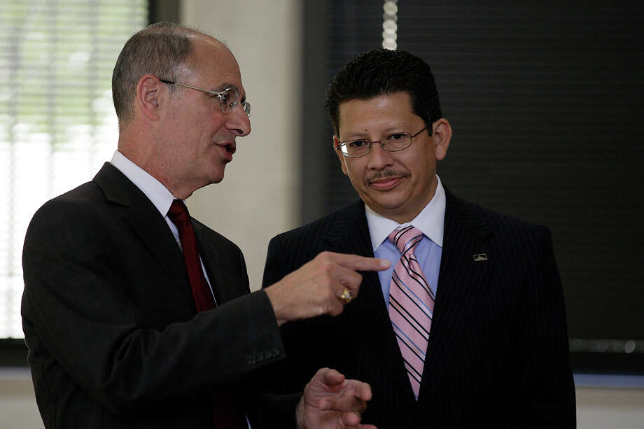 File photo: Developer Marty Wender, left, talks with The Greater San Antonio Chamber of Commerce CEO and President Richard Perez before the San Antonio City Council takes up a resolution condemning the Arizona immigration law, Thursday, June 24, 2010.  Photo: JERRY LARA, San Antonio Express-News / glara@express-news.net