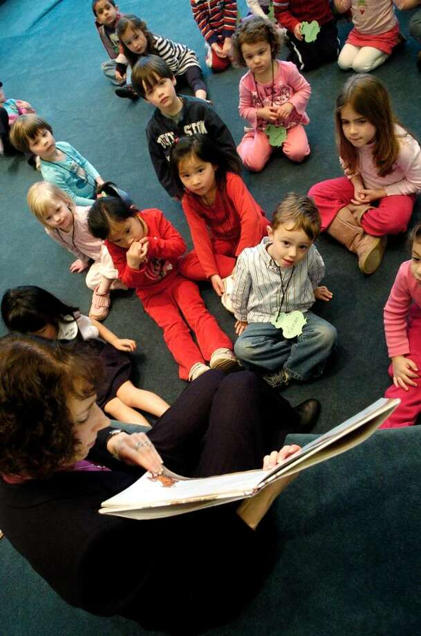 Children's librarian Amy Lolien-Harper reads to preschoolers during story hour at the Harry Bennett branch of the Ferguson Library in Stamford, Conn. on Monday March 22, 2010. Photo: Dru Nadler / Stamford Advocate