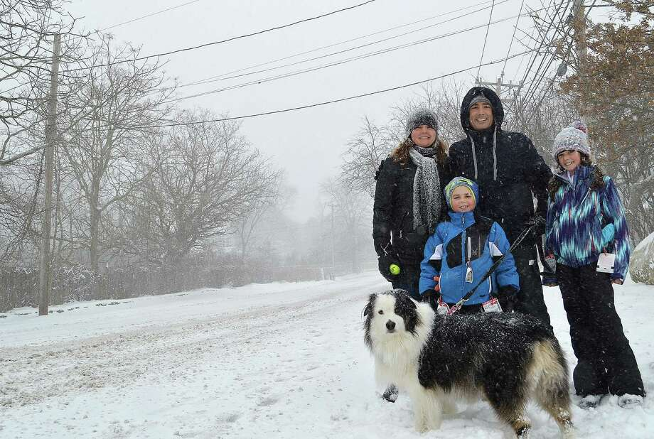 Saturday's storm didn't stop the Caggiano family from a stroll on Compo Road South, including dad Marco, mom Elena, Caroline, 10, John, 7, and Bear. Photo: Westport News / Jarret Liotta / Westport News