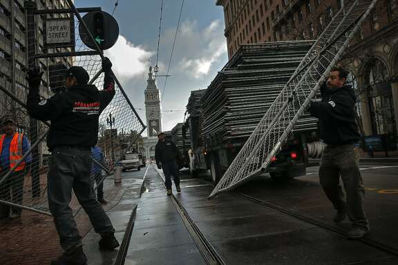 Crews line Market St. and the blocks surrounding Superbowl City with portable fencing at the foot of Market St., on Sat. January 23, 2016, in San Francisco , Calif., as the city prepares for the big event.