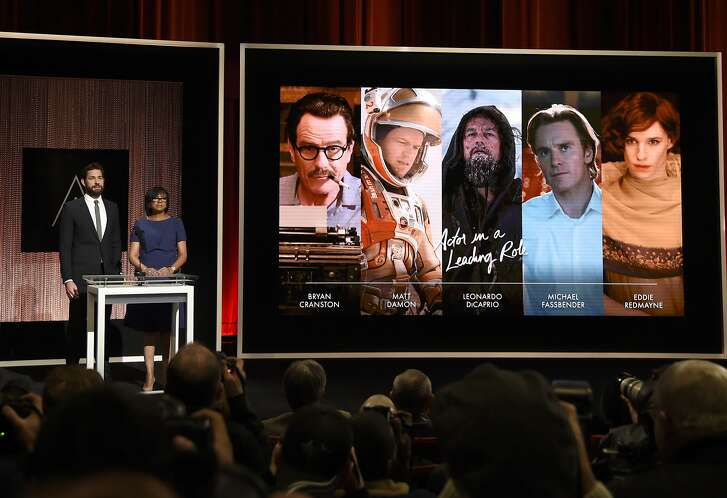 FILE - In this Jan. 14, 2016 file photo, John Krasinski, left, and Academy President Cheryl Boone Isaacs announce the Academy Awards nominations for best performance by an actor in a leading role at the 88th Academy Awards nomination ceremony in Beverly Hills, Calif. The film academy is pledging to double the number of female and minority members by 2020, and will immediately diversify its leadership by adding three new seats to its board of governors. Isaacs announced the changes Friday, Jan. 22,  following a weeklong storm of criticism and calls for an Oscar boycott after academy members nominated an all-white slate of actors for the second year in a row. (Photo by Chris Pizzello/Invision/AP, File)