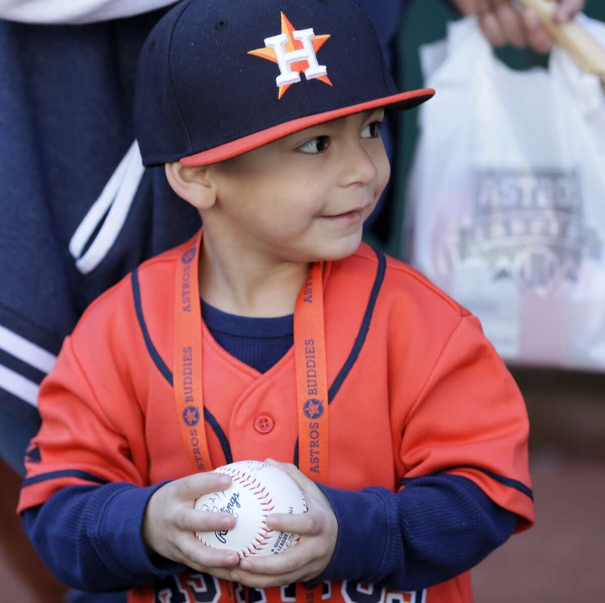 """""""Cubby"""" Garcia, 4, smiles as he holds an autographed baseball at Astros fan fest at Minute Maid Park Saturday, Jan. 23, 2016, in Houston. ( Jon Shapley / Houston Chronicle )"""