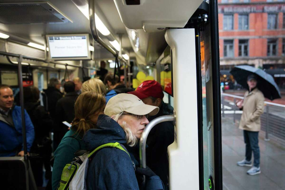Passengers ride and board Seattle's new First Hill streetcar that runs between Pioneer Square, the International District and Capitol Hill, on the route's first day, Saturday, Jan. 23, 2016.