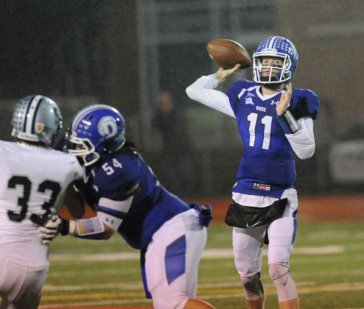 Timmy Graham | Darien | Quarterback Senior completed 223 passes for 3,155 yards and 41 touchdowns (all team records) for the Class LL and FCIAC champion Blue Wave, who also went undefeated with a 12-0 record ... Holds school records for career passing completions (430), career passing yards (5690), career touchdown passes (65) and single-season quarterback rating (134.9) ... CHSCA Class LL offense, All-FCIAC first team offense ... Member of USA Today Connecticut Team.