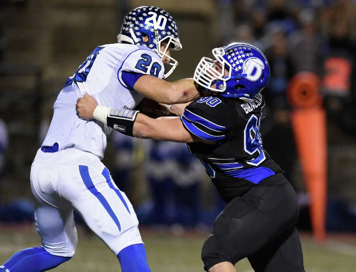 MVP | Mark Evanchick | Darien | Defensive lineman Senior set the state career sack record with 66.5 for the Blue Wave, who won the Class LL and FCIAC championships ... Holds school records for most tackles for a loss in a season (39) and sacks in a season (23.5) ... Named Walter Camp Connecticut High School Player of the Year ... CHSCA All-State first team, All-FCIAC first team defense, Walter Camp All-Connecticut defense ... Member of USA Today Connecticut Team.