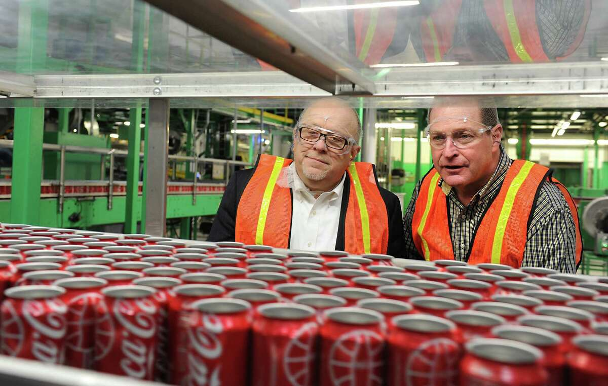 Dennis Brobston, president of Saratoga Economic Development Corporation, left, and Steve DiLoreto, plant manager at Ball Corporation, look over aluminum cans which are made at the Ball Corporation factory on Wednesday, Jan. 20, 2016 in Saratoga Springs, N.Y. (Lori Van Buren / Times Union)