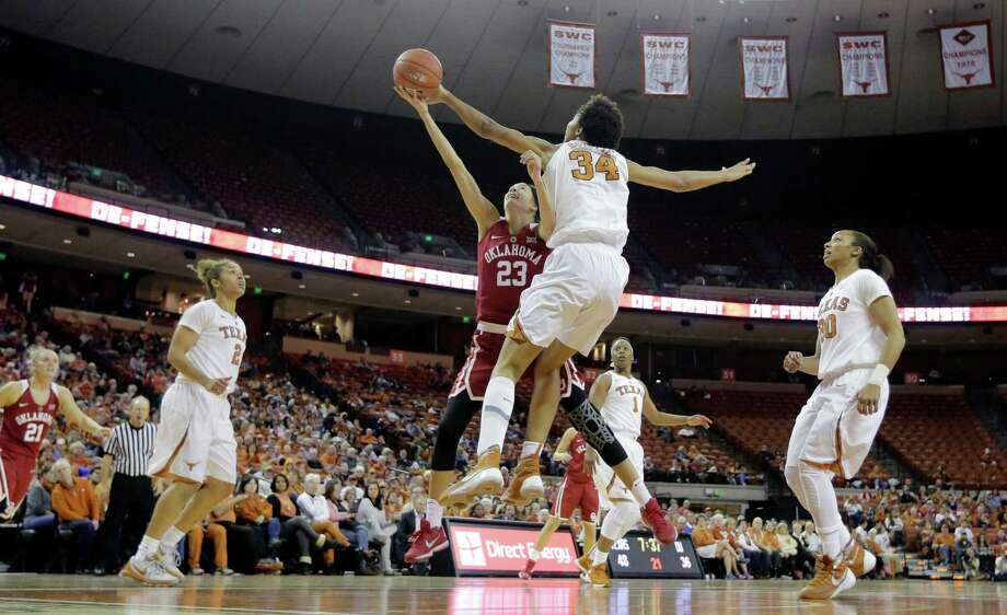 Oklahoma guard Maddie Manning (23) is blocked by Texas center Imani Boyette (34) as she drives to the basket during the second half of an NCAA college basketball game, Saturday, Jan. 23, 2016, in Austin, Texas. Texas won 83-76.(AP Photo/Eric Gay) Photo: Eric Gay, STF / Associated Press / AP