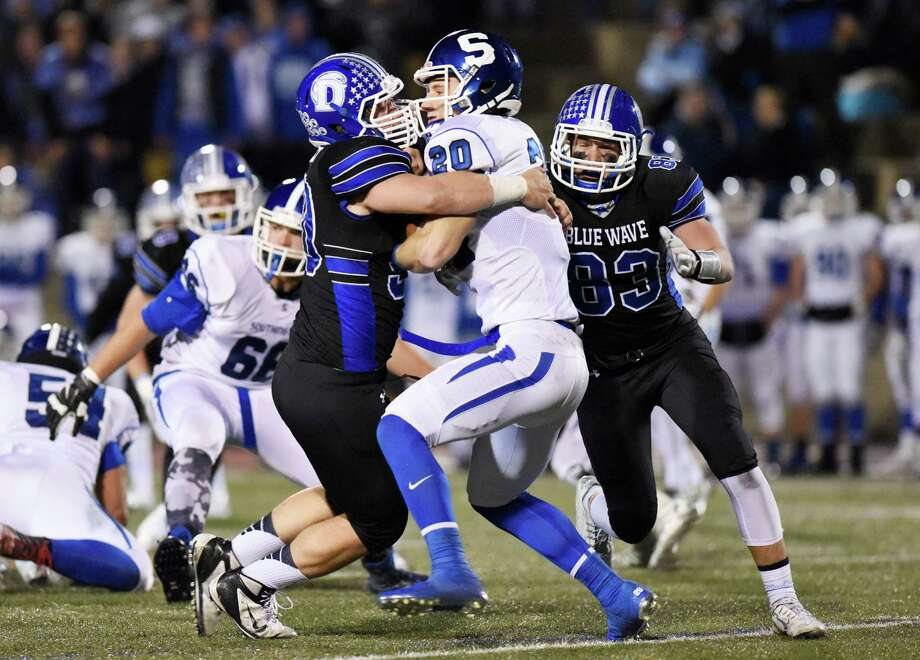 Darien defensive end Mark Evanchick (90) and teammate Quinlin Fay (83) take down Southington quarterback Jasen Rose (20) in the CIAC high school football tournament semifinal game between No. 2 Darien and No. 3 Southington at Boyle Stadium in Stamford, Conn. Monday, Dec. 7, 2015. Photo: Tyler Sizemore / Hearst Connecticut Media / Greenwich Time