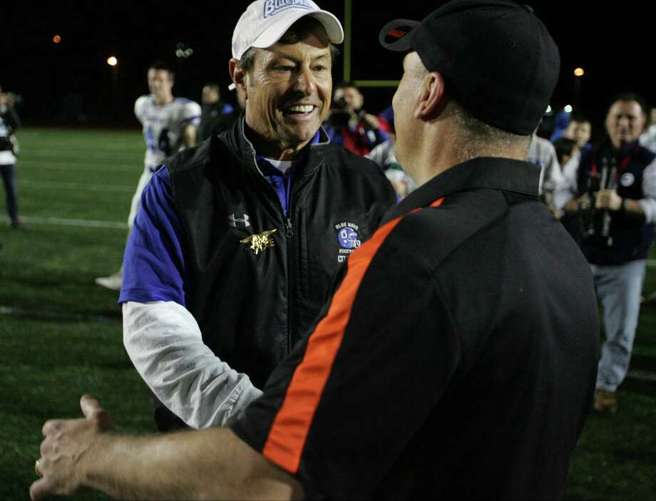 Darien coach Rob Trifone and Shelton coach Jeff Roy shake hands following the CIAC Class LL Championship football game in New Britain, Conn. on Dec. 12, 2015. Darien won 39-7. Photo: Matthew Brown / For Hearst Connecticut Media / Connecticut Post Freelance