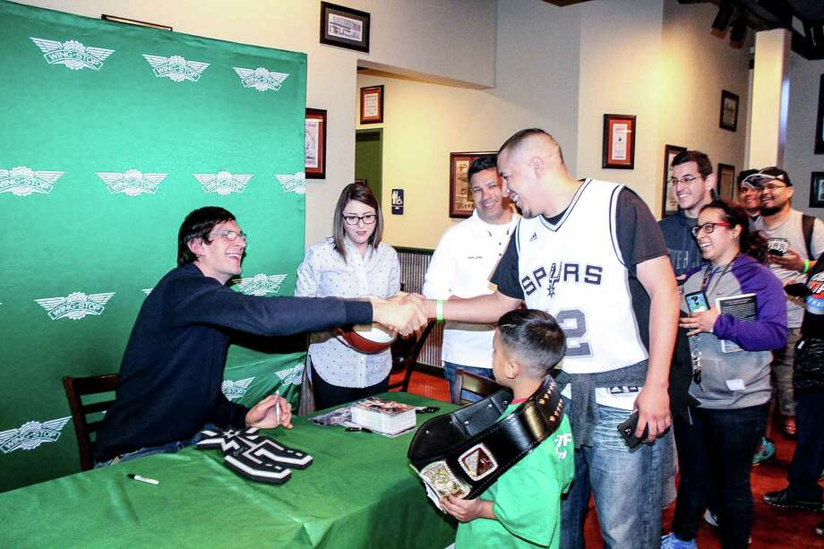 Spurs player Boban Marjanovic signs an autograph for a fan at recent appearance at a local Wingstop restaurant. Photo: Jason Gaines / For Spurs Nation