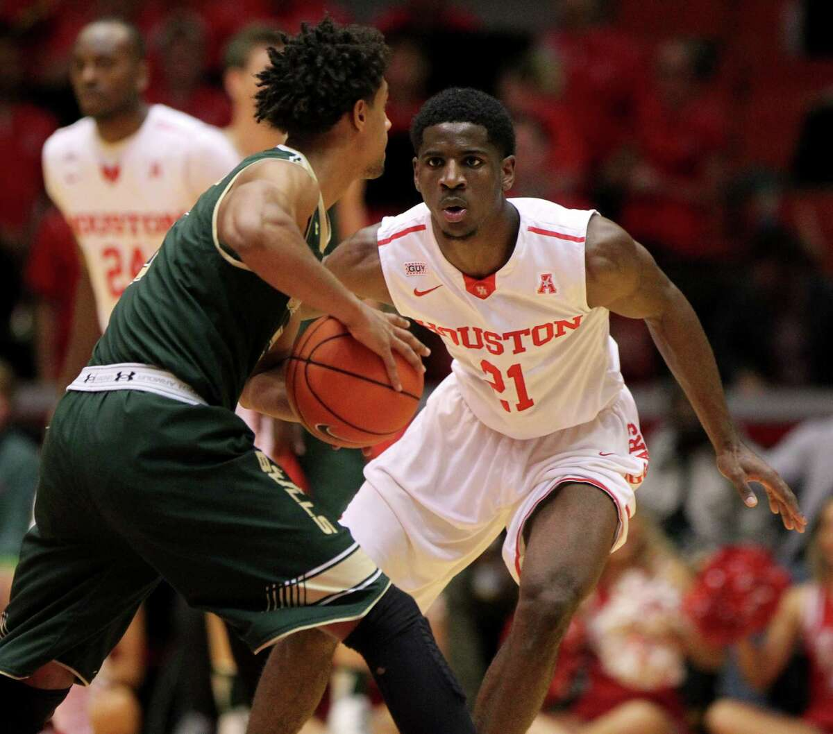 Houston Cougars guard Damyean Dotson (21) guards South Florida Bulls guard Nehemias Morillo (5) during the second half at Hofheinz Pavilion on the campus of the University of Houston Saturday, Jan. 23, 2016, in Houston, Texas. Houston lost 62-71.