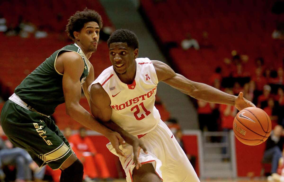 Houston Cougars guard Damyean Dotson (21) attempts to drive around South Florida Bulls guard Nehemias Morillo (5) during the second half at Hofheinz Pavilion on the campus of the University of Houston Saturday, Jan. 23, 2016, in Houston, Texas. Houston lost 62-71.