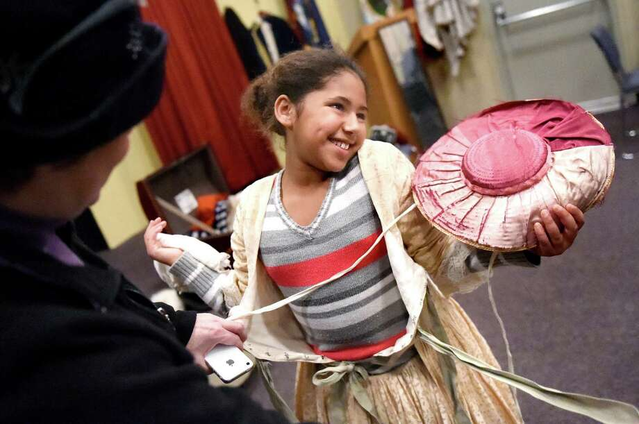 Reese Brinson, 9, of Cohoes, right, dresses up in period clothing during the 21st annual Frost Faire on Saturday, Jan. 23, 2016, at the Saratoga National Historical Park in Stillwater, N.Y. The event, inspired by the Frost Faires in 1700s England, featured horse-drawn carriage rides, children's crafts, contra-dancing, a bonfire and scavenger hunt. (Cindy Schultz / Times Union) Photo: Cindy Schultz / 10034860A