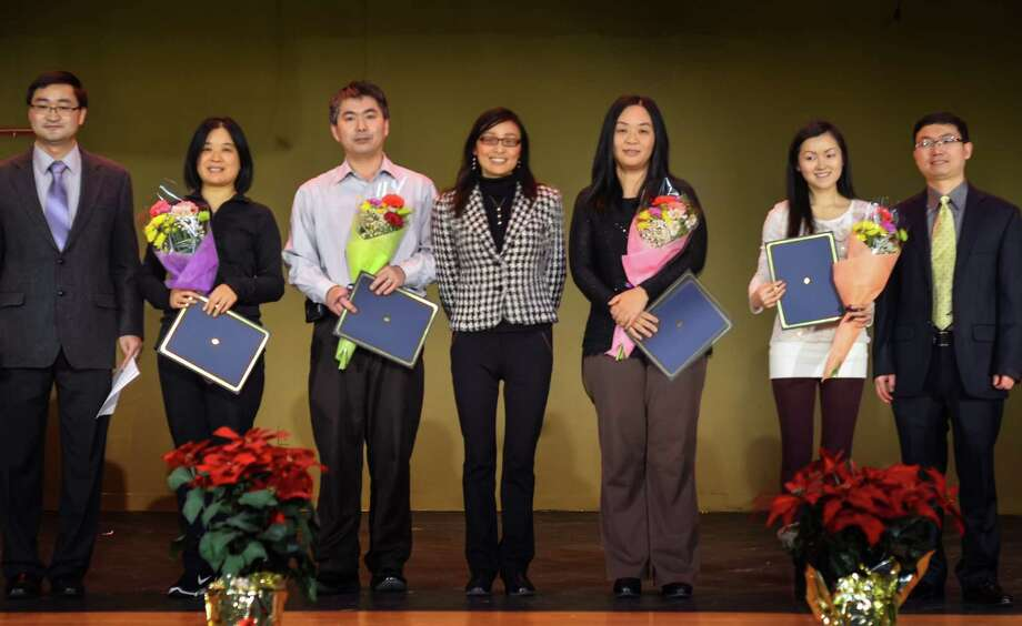Feng Chen, the President of CCC Chinese School in Albany area, presents annual awards of 2015 to outstanding teachers. Every Sunday, around 350 students from Capital area come and learn Chinese and Chinese culture at Shaker Jr. High School Latham.