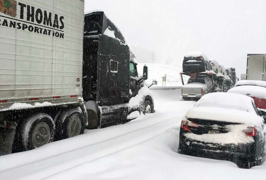 In this photo provided by Michael Watkins, traffic is at a standstill on the Pennsylvania Turnpike near Bedford, Pa., Saturday, Jan. 23, 2016.   The Duquesne men's basketball team and Temple University's women's gymnastics team are stuck on the Turnpike due to treacherous weather conditions. A mammoth winter storm crawled up the U.S. East Coast on Saturday, making roads impassable, shutting down mass transit, and bringing Washington and New York City to a standstill. (AP Photo/Michael Watkins via AP) ORG XMIT: PAJL104 Photo: Michael Watkins / MICHAEL WATKINS