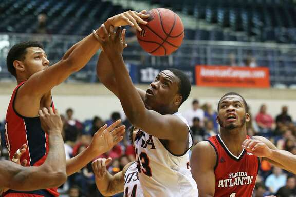 Seven foot center Ronald Delph stretches out to block Roadrunner forward A.J. Cockrell in the second half as UTSA hosts Florida Atlantic in men's basketball at the UTSA Convocation Center on January 23, 2016.
