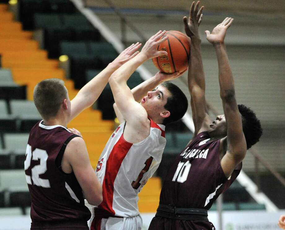 Glens Falls freshman guard Joseph Girard III keeps his eye on the basket after recovering a rebound during a game against Lansingburgh at the Glens Falls Civic Center on Monday, Dec. 28, 2015 in Glens Falls, N.Y. (Lori Van Buren / Times Union) Photo: Lori Van Buren / 10034789A
