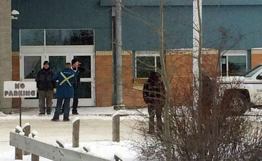 The outside of La Loche Community School is shown on Friday Jan. 22, 2016. Prime Minister Justin Trudeau said the shootings occurred at a high school and another location but did not say where else. School shootings are rare in Canada. The grade 7 through 12 La Loche Community School is in the remote aboriginal community of La Loche, Saskatchewan. (Joshua Mercredi/The Canadian Press via AP)  ORG XMIT: CPT127 Photo: Joshua Mercredi / CP