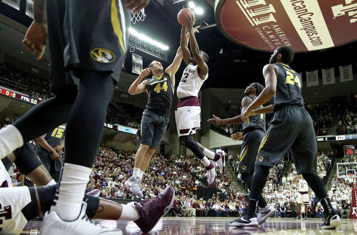 Texas A&M's Jalen Jones (12) grabs a rebound against Missouri's Ryan Rosburg (44) during the first half of an NCAA college basketball game, Saturday, Jan. 23, 2016, in College Station, Texas. (AP Photo/Sam Craft)