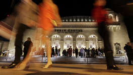 People leave the the Tobin Center for the Performing Arts Thursday Sept. 4, 2014 after the grand opening.